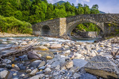 View of old stone bridge over river Stock Photography