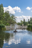 View of an old stone fountain in Hyde Park, London. View of an old stone fountain with flowing water in Hyde Park, London, UK Royalty Free Stock Photos