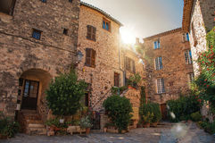 View of old stone houses in alley under shadow at Les Arcs-sur-Argens Stock Image