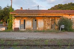 Train station at the abandoned railroad network in Greece. View of an old, stone, train station at the abandoned railroad network of Peloponnese, Greece royalty free stock photography