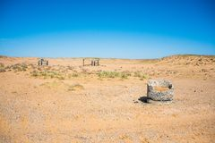 View of old stone water wells in semi-desert royalty free stock photos