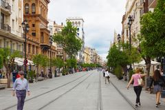 View of old street with old houses in city center of Seville royalty free stock photos