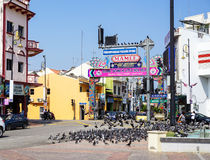 View of old street with many pigeons in Melaka, Malaysia Stock Photos