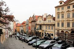 Prague, Czech Republic, January 2015. View of the old street near the royal palace and cars in the parking lot. stock photography