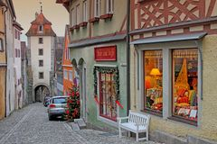 View of old street in Rothenburg, Germany. View of old street in Rothenburg, Germany - medieval city in Germany, popular touristic destination. Christmas time Stock Image