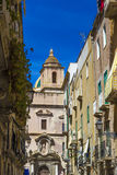 View of old street in Trapani, Sicily with cathedral dome in background Stock Photo