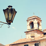 View of Old Tower and Street Lantern Stock Photography