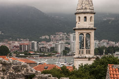 View of the old town of Budva. Against the background of the mountains Stock Photo