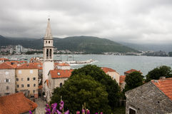 View of the old town of Budva. Against the background of the mountains Stock Images