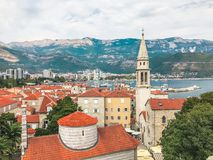 View of the old town of Budva: ancient walls, buildings with a red tiled roof - it`s something like a mini Dubrovnik in Croatia. This picture was taken in Stock Photography