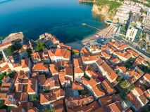 View of old town Budva from the top: Ancient walls and tiled roo Stock Images