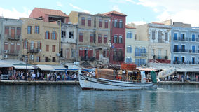 View of the old town in Chania, Greece. Motorboat, bulding, sea, esplanade, chania, greece, people Stock Image