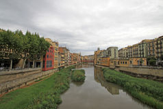 View of the old town with colorful houses on the bank of the river Onyar. GIRONA, SPAIN Stock Photos