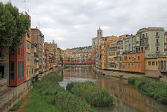 View of the old town with colorful houses on the bank of the river Onyar. GIRONA, SPAIN Royalty Free Stock Photos