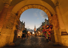 View on the old town of Gdansk through the arch. View of the old town of Gdansk with the Main Town Hall through the arch of Green Gate in the sunset, Poland Stock Image