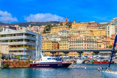 A view on the old town and harbor with carabinieri boat in Genoa, Italy royalty free stock photos