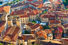 View of old town of Kotor on sunset. Red tiled roofs Stock Photos