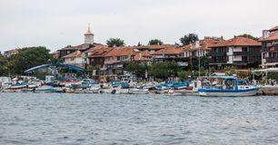 View at the old town of Nesebar and boats in the seaport. Royalty Free Stock Photo