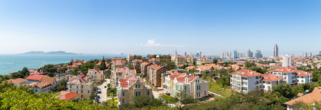 View of Old town and Qingdao bay from XiaoYuShan Park. View of Old town and Qingdao bay from the hill of XiaoYuShan Park, Qingdao, China Stock Images