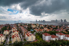View of Old town and Qingdao bay from XiaoYuShan Park. View of Old town and Qingdao bay from the hill of XiaoYuShan Park on a rainy summer day, Qingdao, China Stock Photography