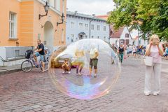 View of the old town square of Tallinn and tourists through the big soap bubble stock photos