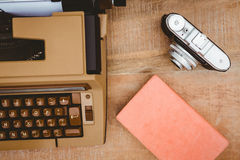 View of an old typewriter and camera Royalty Free Stock Photos