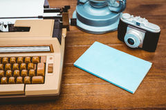 View of an old typewriter and camera Stock Images