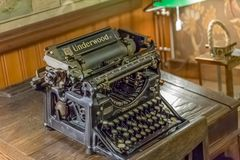 View of old typewriter, on top of wooden table royalty free stock images