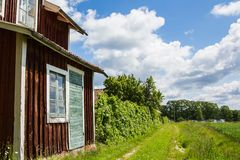 View of an Old Village in Sweden With a Blue Cloudy Sky. And Green Grass Field Royalty Free Stock Photography