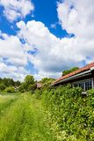 View of an Old Village in Sweden With a Blue Cloudy Sky Stock Photography