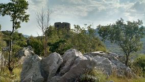 The old watchtower in the mountains of Montenegro stock image