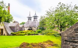 An old whiskey distillery in the north of Scotland. View of An old whiskey distillery in the north of Scotland royalty free stock image