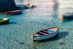View of old wooden boat moored in little bay. In Italian city, Europe royalty free stock photography