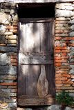 Old wooden door, contrast shadow. View of an old wooden door, contrast shadow royalty free stock photo