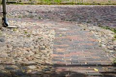View of an older paved street with stone blocks stock images