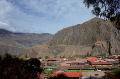 A view of Ollantaytambo town and the Inca ruins. Carved into the mountain side royalty free stock photos
