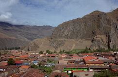 A view of Ollantaytambo town and the Inca ruins. Carved into the mountain side stock photography