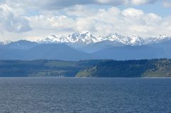 View of the Olympic Mountain Range with Mt Constance and the Hood Canal stock images