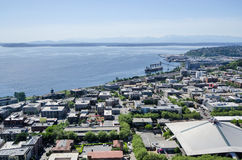 View of the Olympic Mountains and Key Arena from the Space Needle. View of Elliott Bay from the Space Needle. Boats are in the water, Key Arena of the Seattle Royalty Free Stock Image
