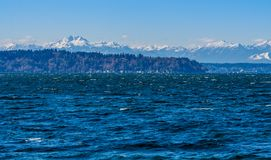 Mountains From Seahurst Beach. A view of the Olympic Mountains from Seahurst Beach Park in Burien, Washington stock photography