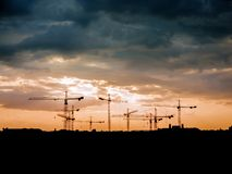 Free View On A Consturction Site With Cranes During Sunset Stock Photo - 164843730