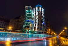Free View On A Dancing House In Prague, Chech Republic. Light Traces Made By Tram And Cars, Shot With Long Exposure By Night Royalty Free Stock Image - 165590676