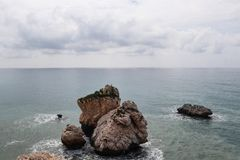 Free View On Aphrodite´s Rock From Bigger Hill On Petra Tou Romiou Beach. Incredible Clear Water In Mediterranean Sea With Cloudy Sky Stock Photography - 146788772