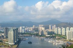 View of one of the districts of Sanya city. Visible are the skyscrapers and the public ferry terminal. Hainan, China. View of one of the districts of Sanya city royalty free stock photography