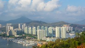 View of one of the districts of Sanya city. Visible are the skyscrapers and the public ferry terminal. Hainan, China. View of one of the districts of Sanya city stock photo