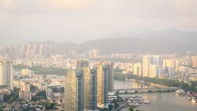 View of one of the districts of Sanya city. Visible are the skyscrapers. Sunset, blur, haze. Hainan Island, China.  stock image