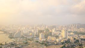 View of one of the districts of Sanya city. Visible are the skyscrapers. Sunset, blur, haze. Hainan Island, China.  royalty free stock images