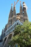 View of one of the facades of La Sagrada Familia, Barcelona, from the side of the park. royalty free stock photos