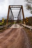 Historic One Lane Truss Bridge & Dirt Road - Somerset County, Pennsylvania. A view of a one-lane dirt road leading up to the historic Moser Road truss bridge Stock Photo