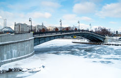 Bridge over Moskva River. View of one of the many bridges crossing the Moskva River in Moscow, during winter time with a frozen river stock images